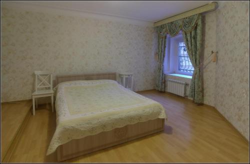 Кровать или кровати в номере Апартаменты Большая Морская 31