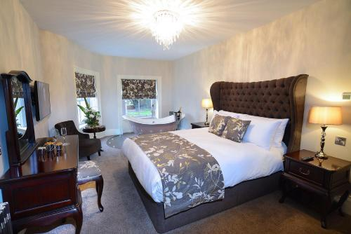 A bed or beds in a room at The Morecambe Hotel