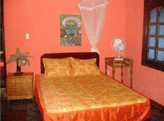 A bed or beds in a room at Pousada Villa Amari