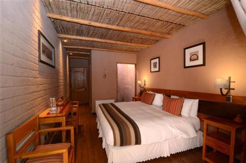 Cama ou camas em um quarto em Hotel Pascual Andino