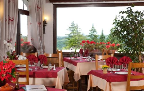 A restaurant or other place to eat at La Petite Chaumiere
