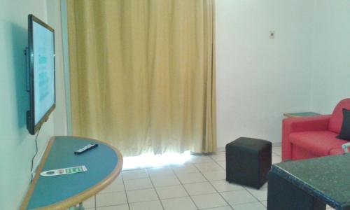 A seating area at Apartamento Eldorado Thermas Park