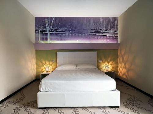 Letto o letti in una camera di Locanda Ristorante 7 Mari
