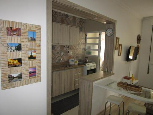 A kitchen or kitchenette at Apartamento Cristóvão