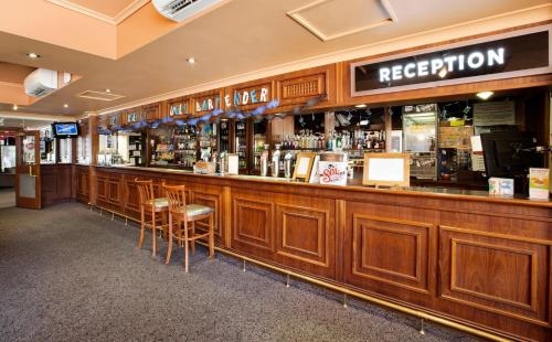 The lounge or bar area at Enfield Hotel
