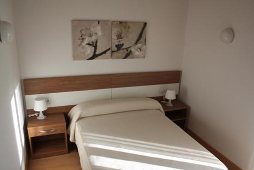 Cama o camas de una habitación en Alojamiento Ubaldo Nieto