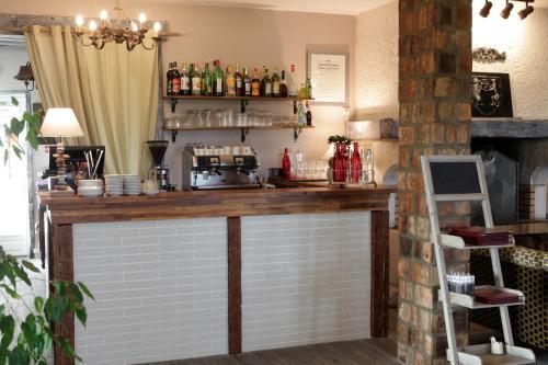 The lounge or bar area at Hôtel Les Nymphéas