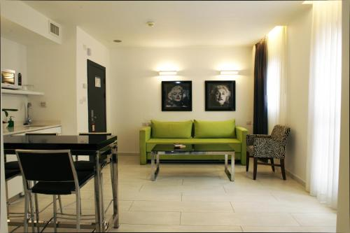 A seating area at Best Western Regency Suites