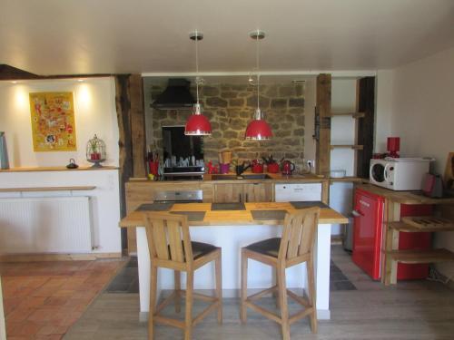 A kitchen or kitchenette at Hauts De La Brancherie