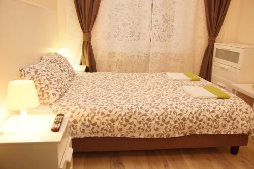 Кровать или кровати в номере Мини-отель Спокойной ночи на Киевской