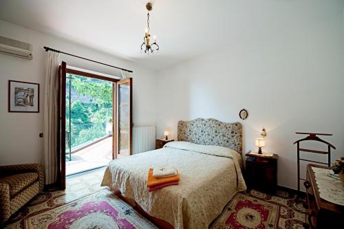 A bed or beds in a room at Villa Punta del Sole
