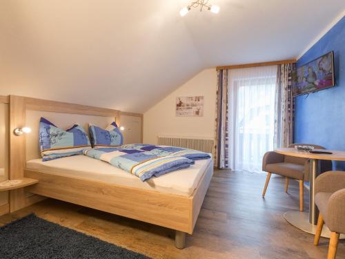 Postel nebo postele na pokoji v ubytování Haus Pitzer/Apartments Troicher
