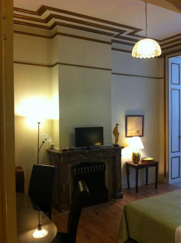A television and/or entertainment center at Hotel Residence 18