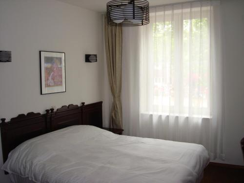 A bed or beds in a room at Hotel Keistad