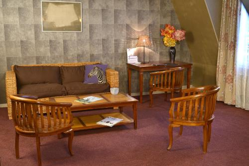 A seating area at Best Western Les Beaux Arts