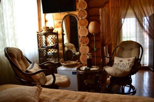 Гостиная зона в Uyutniy Dom Inn