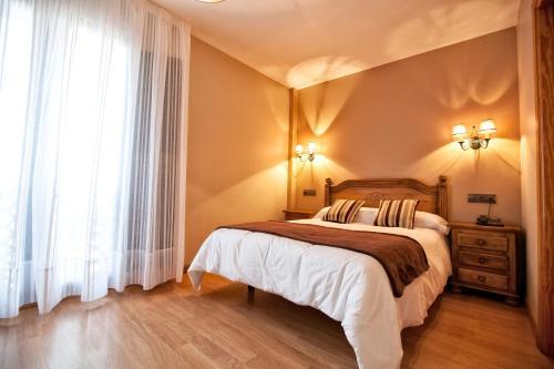 Cama o camas de una habitación en Hotel Santa Cruz