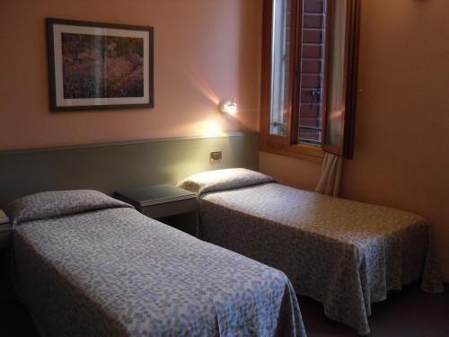 Letto o letti in una camera di Hotel Castello