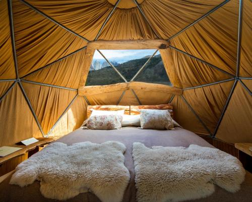 A bed or beds in a room at Ecocamp Patagonia