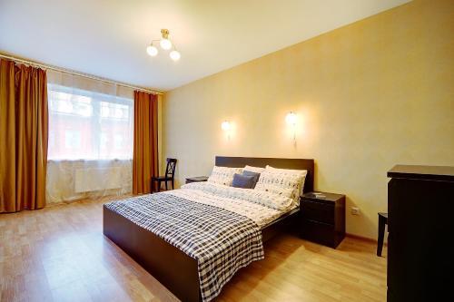 Кровать или кровати в номере Welcome Home Apts Ligovsky 123