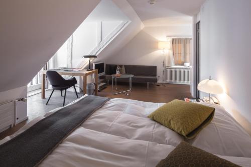 Ein Bett oder Betten in einem Zimmer der Unterkunft Baseltor Hotel & Restaurant