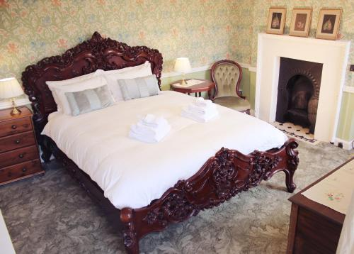 A bed or beds in a room at Dollardstown Historic Country House B&B