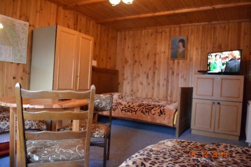 Łóżko lub łóżka w pokoju w obiekcie Pokoje Gościnne Na Skraju Wsi