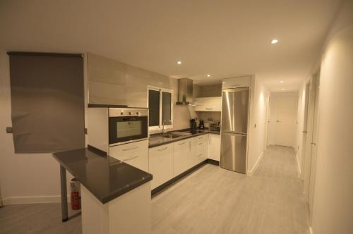 A kitchen or kitchenette at Apartamento Victoria