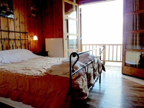 Ένα ή περισσότερα κρεβάτια σε δωμάτιο στο Ξενωνας Κυλλήνη