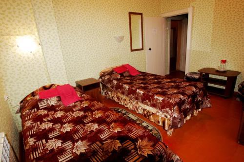 Кровать или кровати в номере Гостиница Валдай