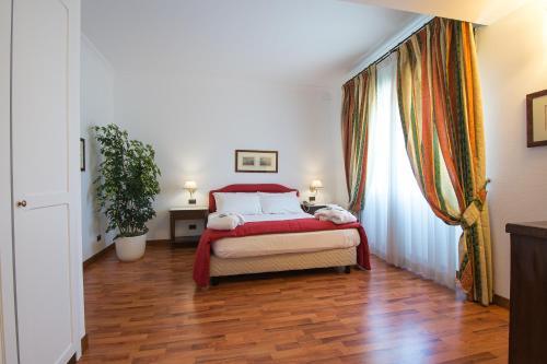 Кровать или кровати в номере Hotel Della Valle