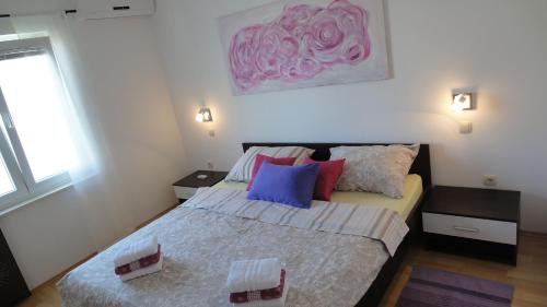 A bed or beds in a room at Apartments Tomić
