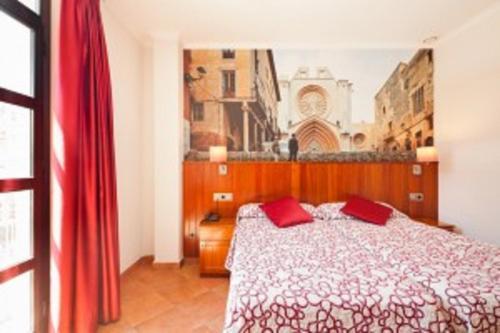 Llit o llits en una habitació de Plaça De La Font