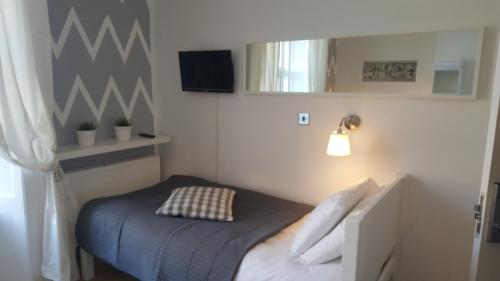 A bed or beds in a room at Durban Residence