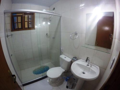 A bathroom at Suítes do Cid