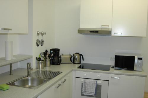 Küche/Küchenzeile in der Unterkunft Carlotel