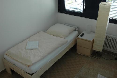 Ein Bett oder Betten in einem Zimmer der Unterkunft Carlotel