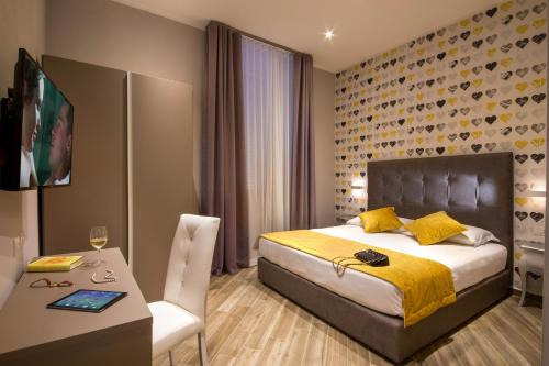 A bed or beds in a room at Frattina Rooms
