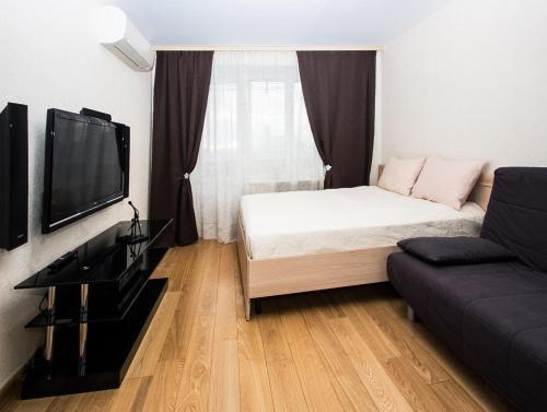 Кровать или кровати в номере ApartLux Улучшенные Апартаменты на Динамо