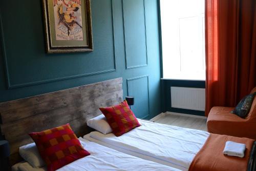 Кровать или кровати в номере Sweet Village Hostel Ligovskiy