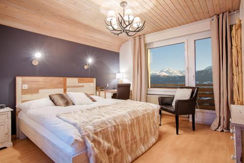 Ein Bett oder Betten in einem Zimmer der Unterkunft Hotel du Lac