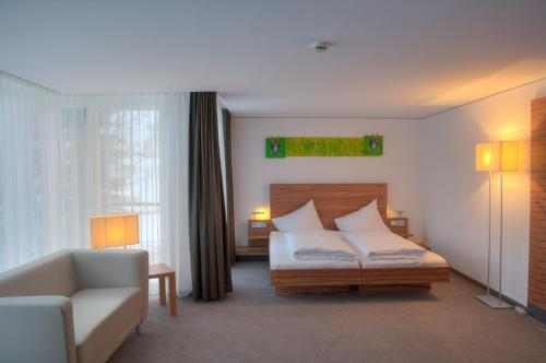 A bed or beds in a room at Pepis Skihotel