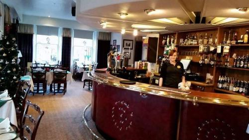 The lounge or bar area at The Royal Hotel Tain