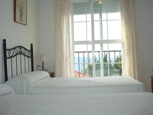 A bed or beds in a room at Hotel restaurante El Duque