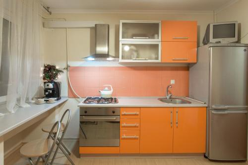 A kitchen or kitchenette at Central Barkar Apartments
