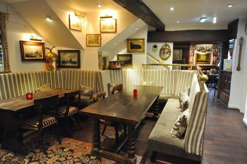 A restaurant or other place to eat at The Greyhound Coaching Inn