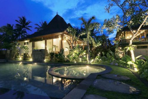 The swimming pool at or near Masia Villa Ubud