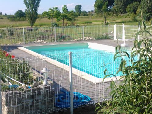 The swimming pool at or near Gites Gayet
