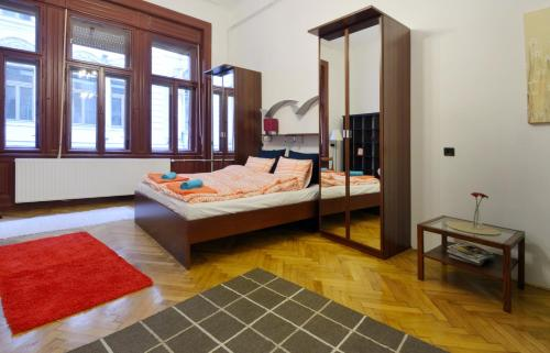 A bed or beds in a room at Red Trees Apartment