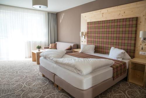 A bed or beds in a room at Boutique Hotel Erla